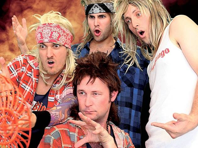 Four men dressed up in flannel shirts with mullet wigs