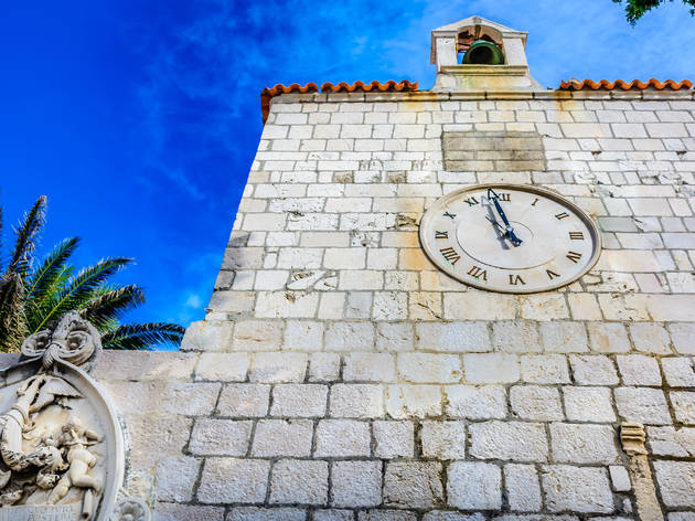 adriatic,architecture,bell,building,clock,croatia,croatian,culture,dalmatia,details,duke,european,exterior,facade,famous,historic,island,landmark,medieval,mediterranean,monument,old,outdoors,pag,palace,palm,rector,residence,stone,symbol,tower,town,travel,