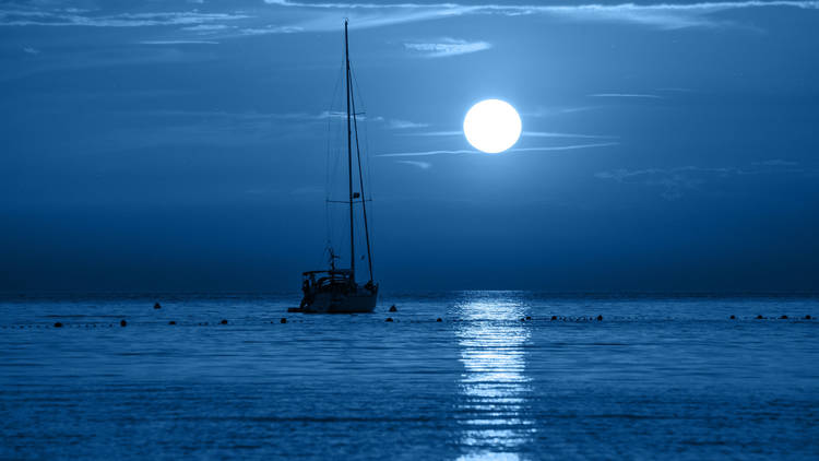 Beautiful night sea, yacht and full moon. Night classic blue seascape. Trendy Banner with color of the year 2020