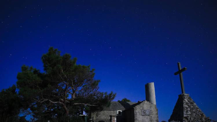 The midnight sky over medieval buildings on Lošinj island