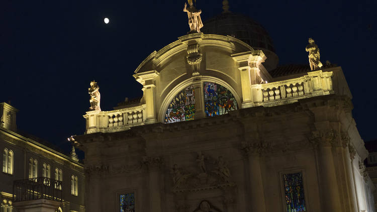 The moon watches over Old Town Dubrovnik and its Church of St. Blaise