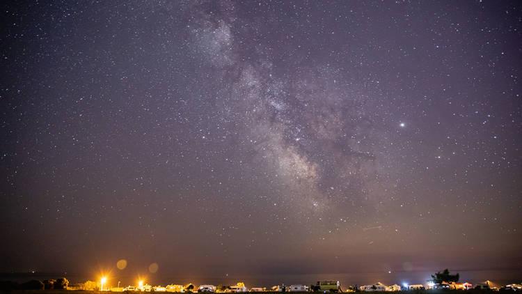 Magic night stars milky way seaside camping background