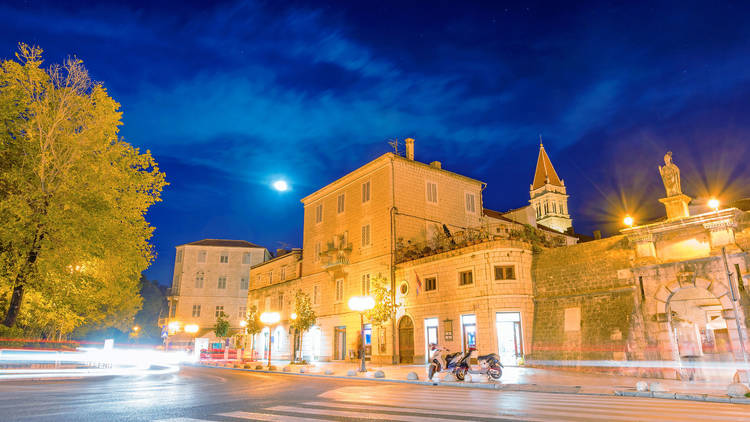 Even from behind the clouds, the moon lights up the nighttime centre of Trogir