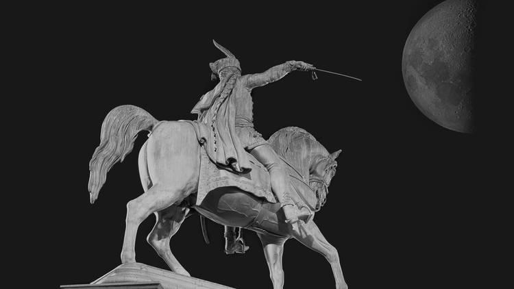 Horseman with sword under the Moon