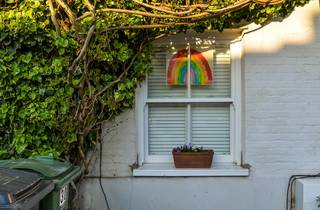london house with NHS rainbow poster