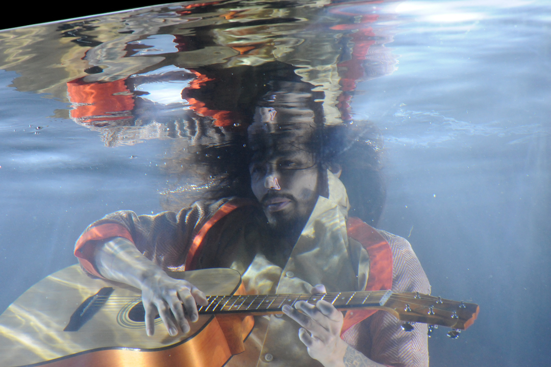 Man with guitar underwater in Lars Jan's Holoscenes