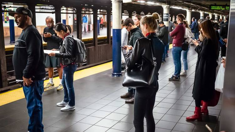 people standing in subway cars