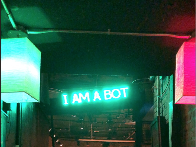 "Neon sign saying ""I AM A BOT"" in the Blurring Test—Songs from MrMind"
