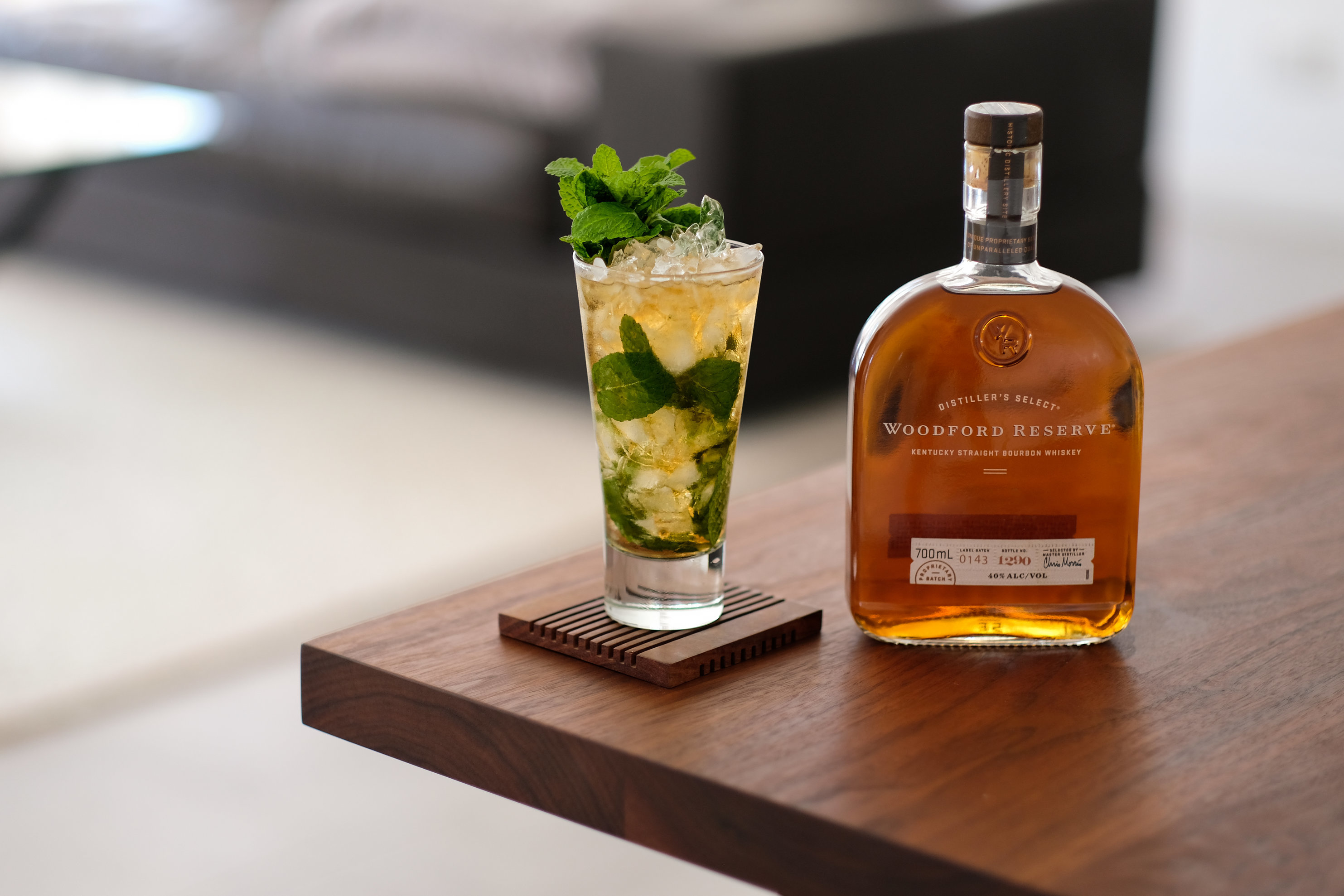Mint Julep in a tall glass next to Woodford Reserve