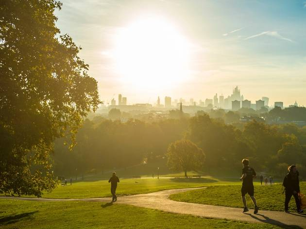 Runners on Primrose Hill during a London heatwave