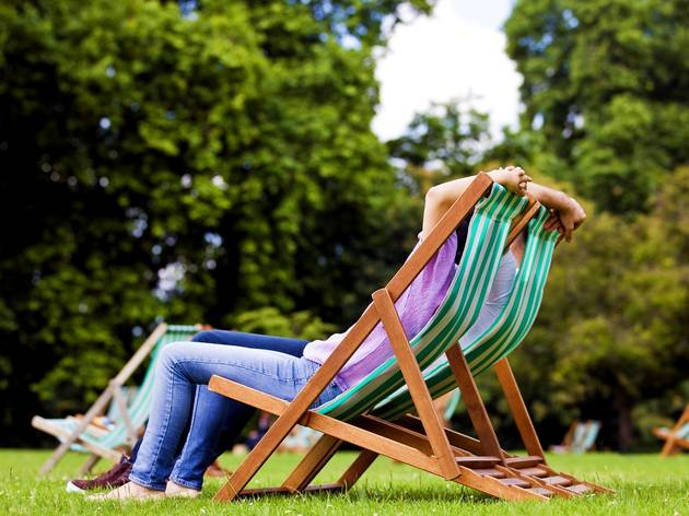 couple sitting on deck chairs in St James Park