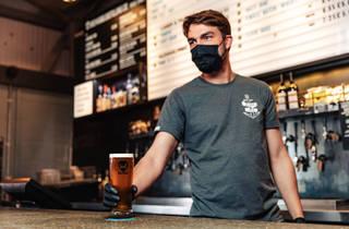 BrewDog serving with face mask