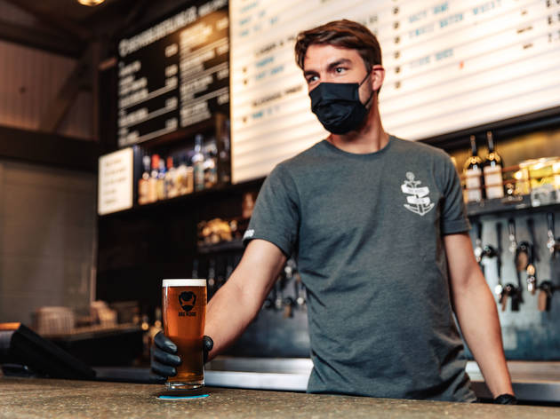 BrewDog serving with face mask