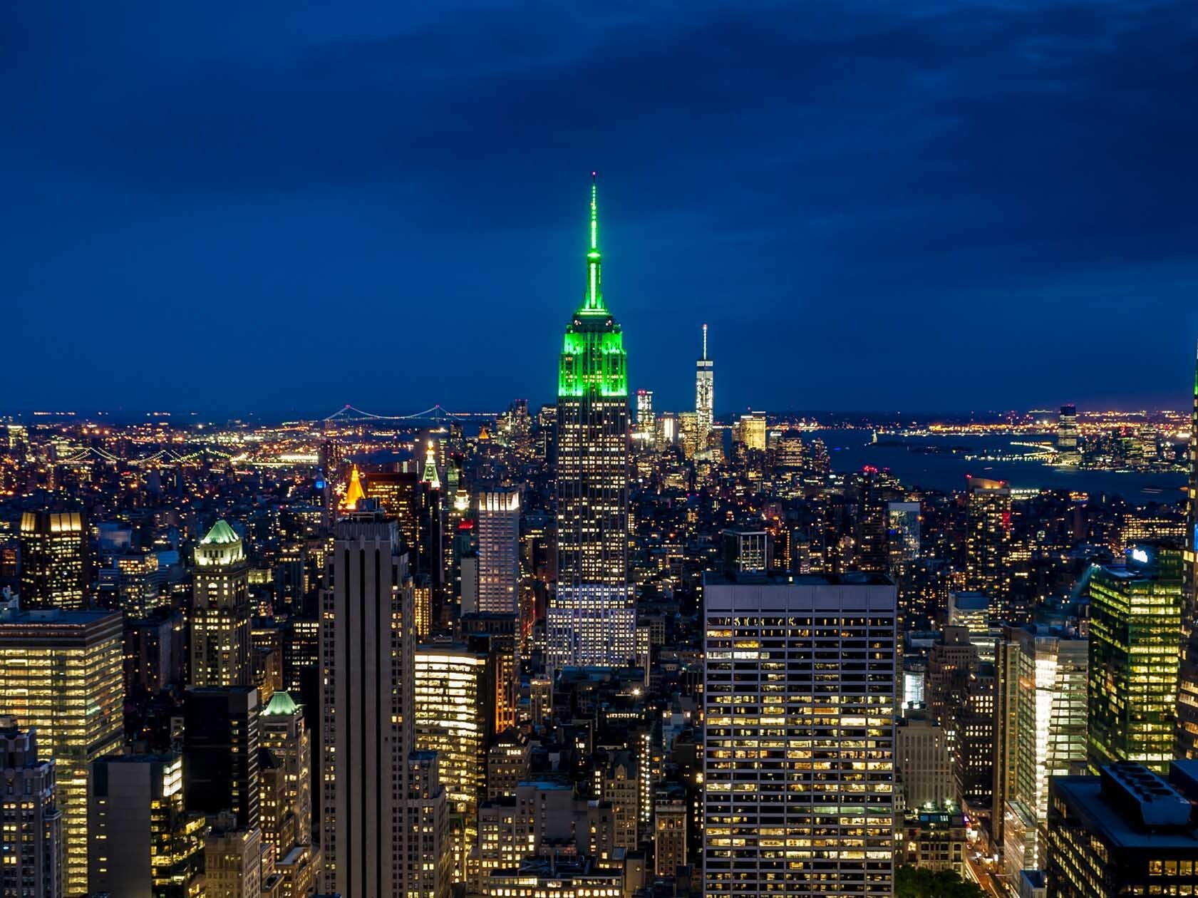 NYC landmarks are lighting up green tonight for essential park workers
