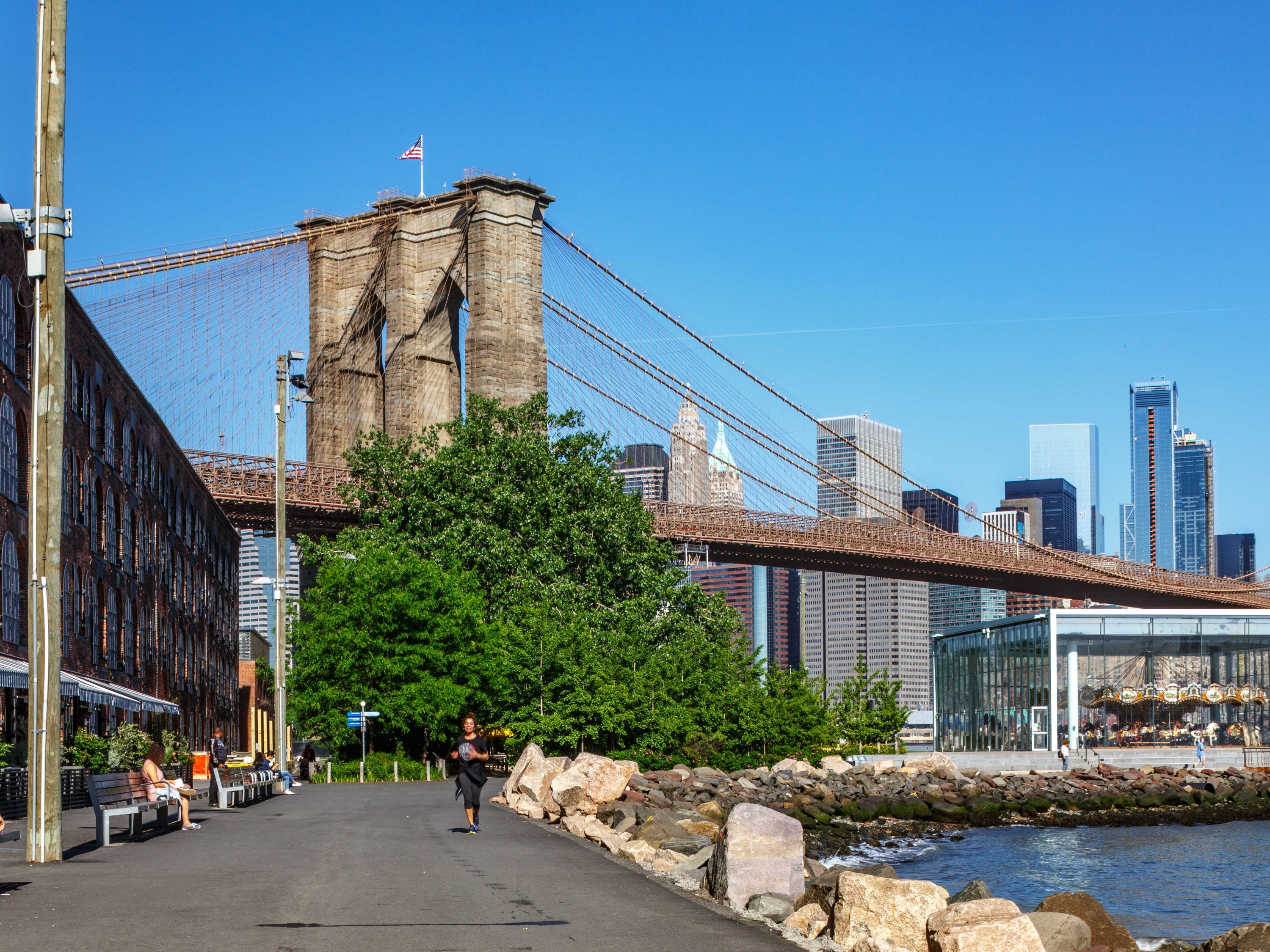 A two-acre green space is opening under the Brooklyn Bridge