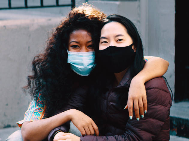 two women with masks on