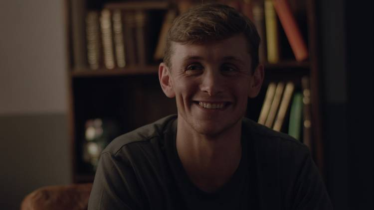 Man smiling in a room
