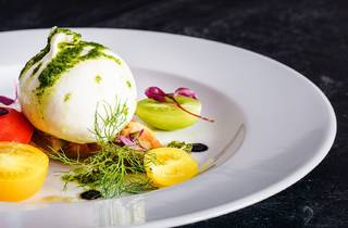 A beautifully plated burrata cheese.