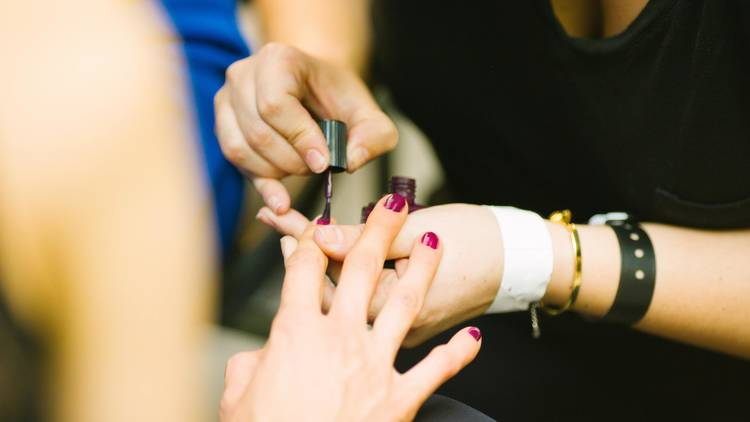 Woman gets her nails painted