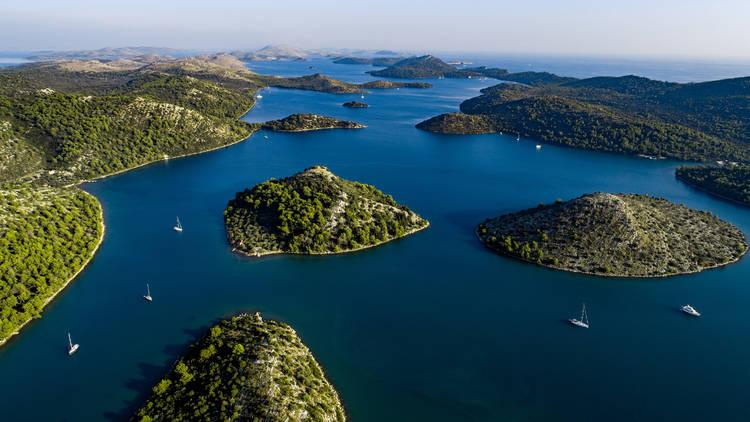 Sailboats Exploring Archipelago in Mediterranean Sea.