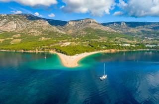 Aerial view of sea and mountains behind,Bol town, Zlatni rat, Croatia