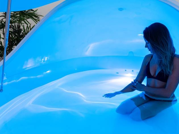 A woman in a floatation tank