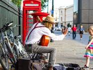 London busker and a little girl
