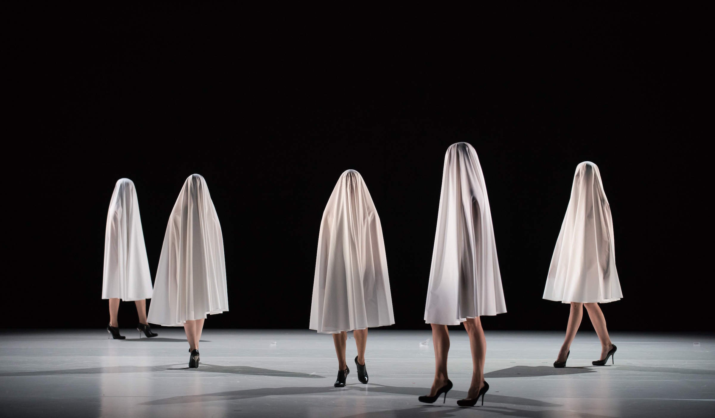 Women covered in sheets in Hussein Chalayan's Gravity Fatigue
