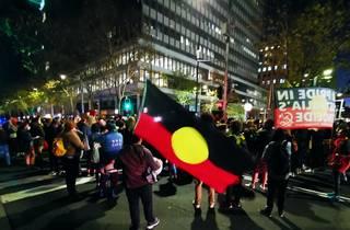 Aboriginal flag and protestors