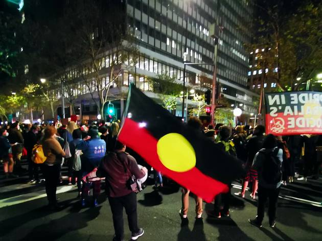 Aboriginal flag and protestors