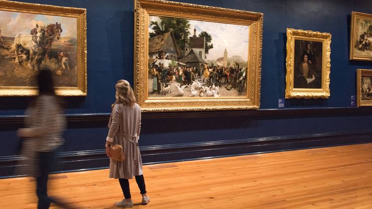 Women standing in front of paintings at Bendigo Art Gallery