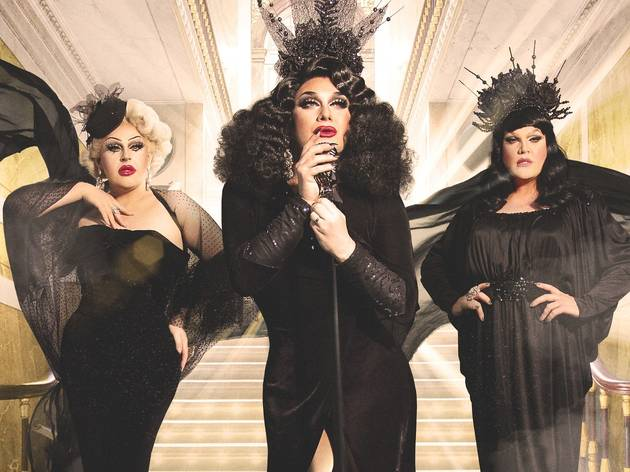 Three drag queens in glamorous black outfits