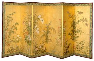 A folded screen with a yellow background with flowers painted over the top