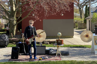 Jason Narducy performing an outdoor concert