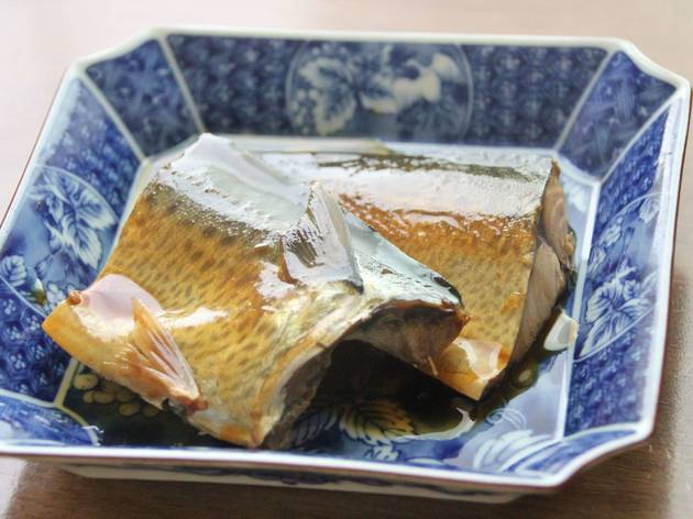 Braised mackerel on a blue dish