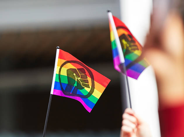 Black Lives Matter logo on rainbow flags at Pride