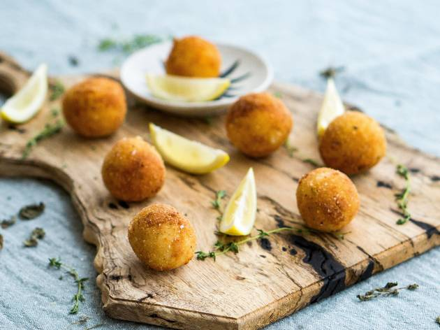 balls and lemon wedges on wooden board