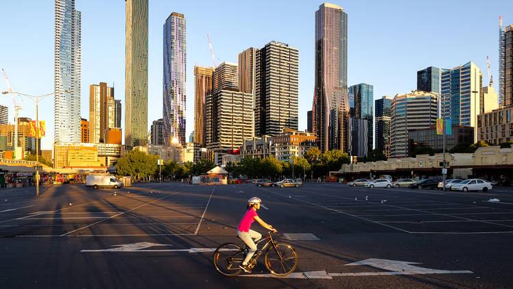 Melbourne person on bike near Queen Vic Market