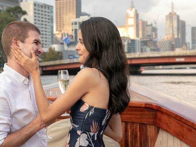 Couple on a boat on the Yarra with Champagne