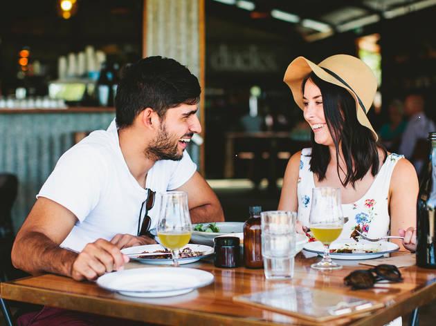 A couple eats at the Three Blue Ducks at the Farm
