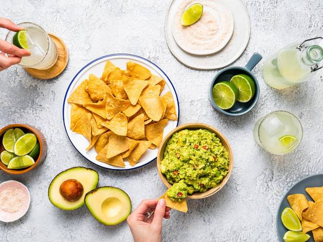 chips, avocados, limes in a flatlay