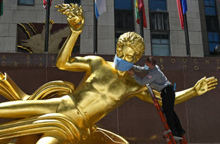 Rockefeller Center Statues Dressed Wearing Masks to Coincide with New York City Entering Phase Two of Reopening