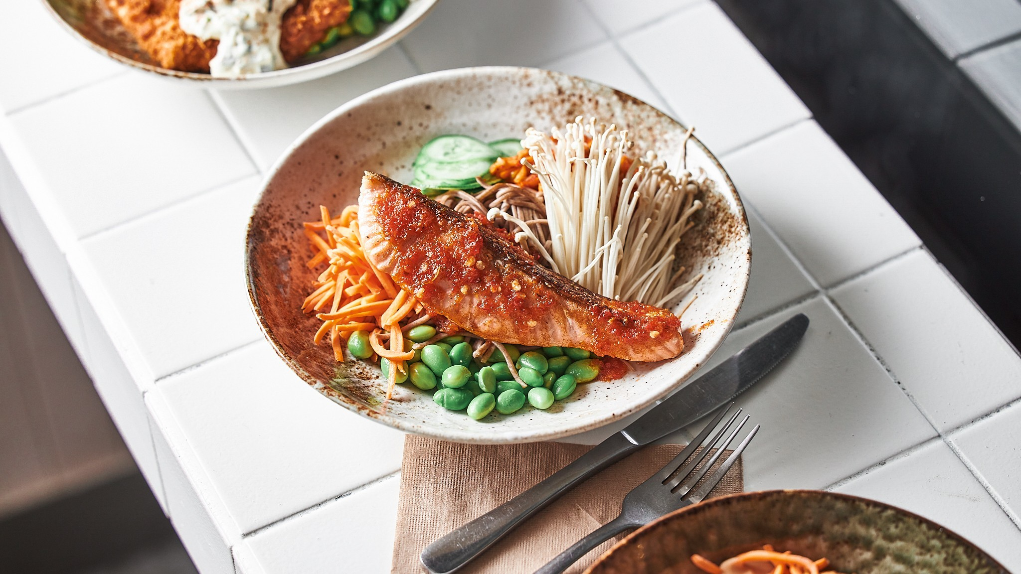 Fish, edamame and carrot in a bowl