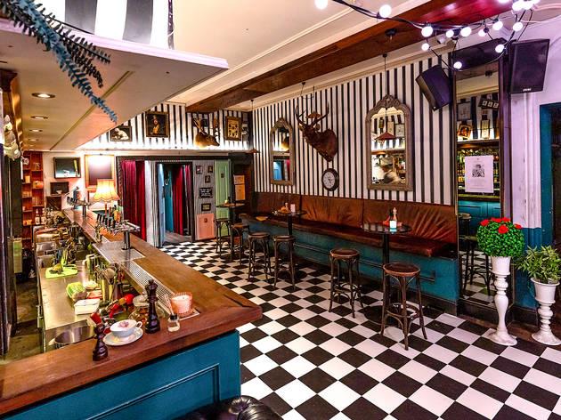Alice in wonderland themed bar at Bar Alice