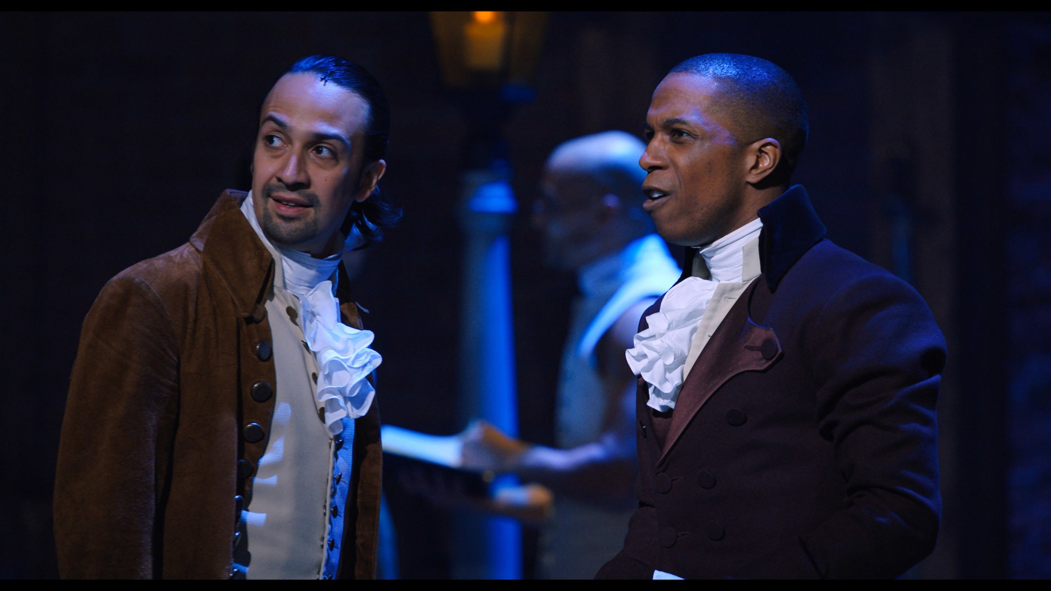 Lin-Manuel Miranda is Alexander Hamilton and Leslie Odom, Jr. is Aaron Burr in HAMILTON, the filmed version of the original Broadway production.