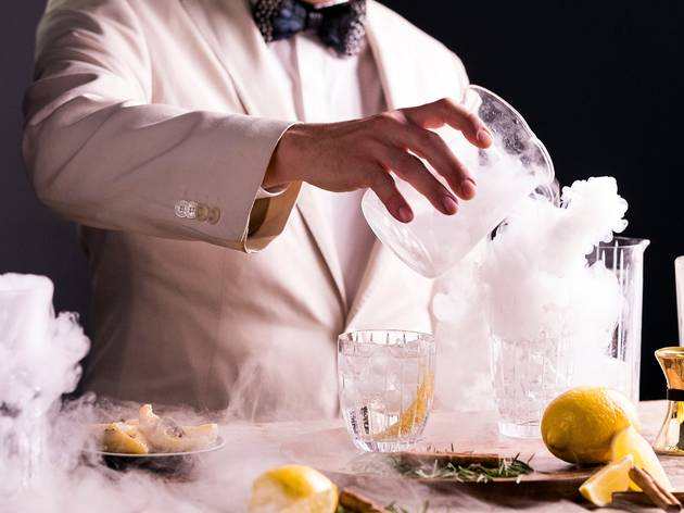 Man pouring gin cocktail