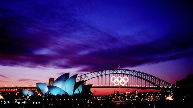 Harbour bridge lit up with Olympics logo