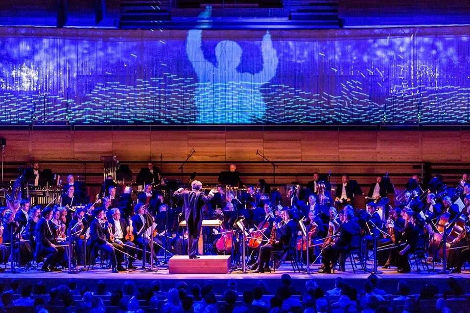 The Montreal Symphony Orchestra's playing an open-air concert at an airport next month