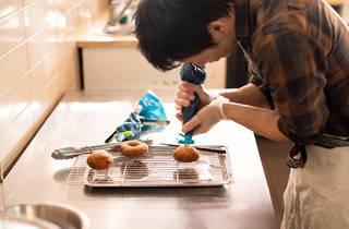 Comeco Foods decorating donuts (Photograph: Daniel Boud)