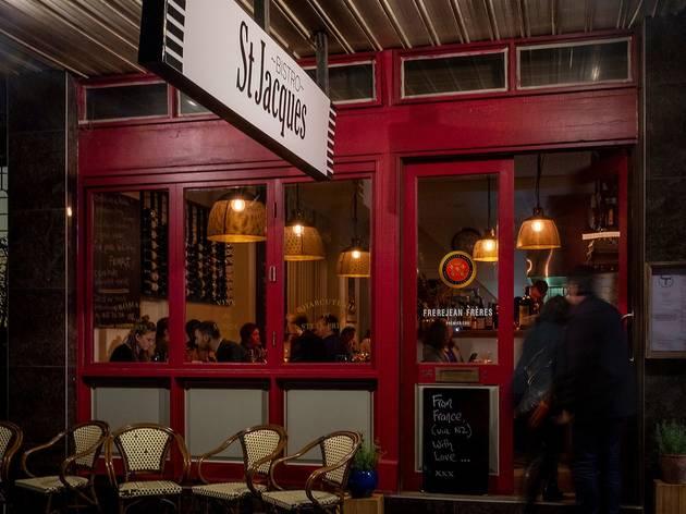 Man walking into red restaurant
